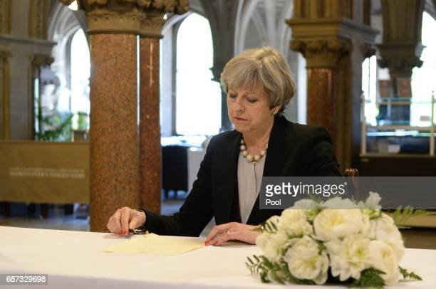 Prime Minister Theresa May writes a message to the people of Manchester at Manchester Town Hall on May 23 2017 in Manchester England A 23yearold man...