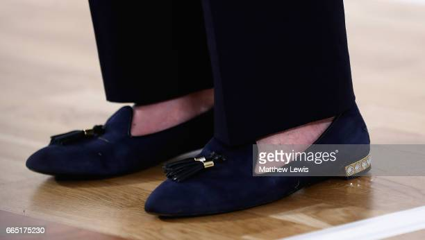 Prime Minister Theresa May's shoes pictured during a speech as she Launches The Conservative Party Local Election Campaign at Calverton Village Hall...