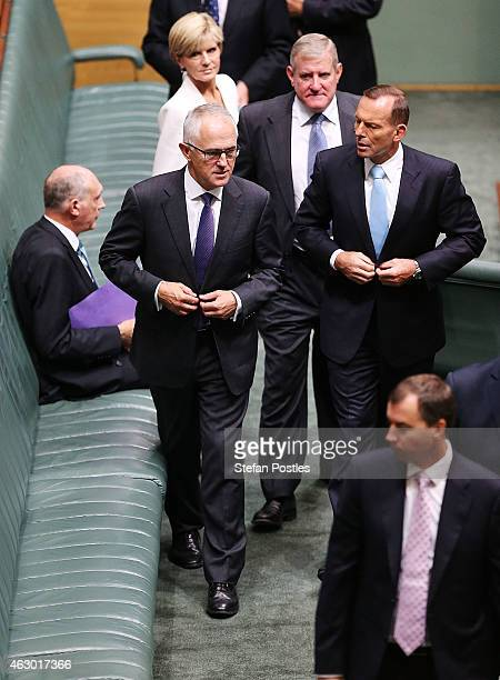 Prime Minister Tony Abbott and Minister for Communications Malcolm Turnbull leave the House of Representatives chamber at Parliament House on...