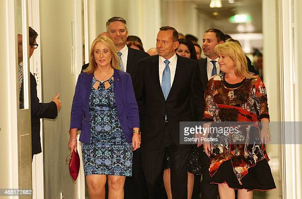 Prime Minister Tony Abbott and supporters arrive at the Liberal party room for the leadership ballot at Parliament House on September 14 2015 in...