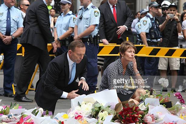 Prime Minister Tony Abbott and wife Margie pay their respects at the Martin Place memorial site on December 16 2014 in Sydney Australia Sydney siege...