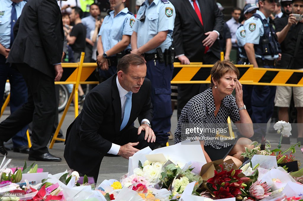 Prime Minister <a gi-track='captionPersonalityLinkClicked' href=/galleries/search?phrase=Tony+Abbott&family=editorial&specificpeople=220956 ng-click='$event.stopPropagation()'>Tony Abbott</a> and wife Margie pay their respects at the Martin Place memorial site on December 16, 2014 in Sydney, Australia. Sydney siege gunman Man Haron Monis, was shot dead by police in the early hours of Tuesday morning after taking hostages at the Lindt Chocolat Cafe in Martin Place. Two other people died, 33-year-old cafe manager Tori Johnson and 38-year-old Sydney barrister Katrina Dawson. Six people have been injured and have been taken to hospital.