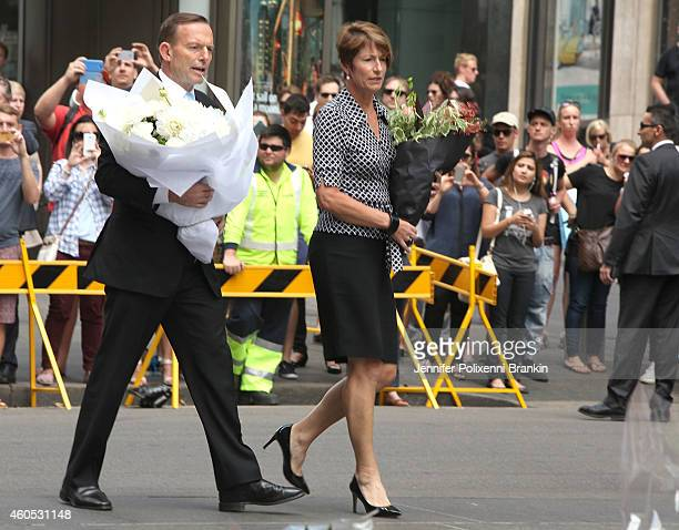 Prime Minister Tony Abbott arrives with his wife Margaret to pay their respects at Martin Place on December 16 2014 in Sydney Australia The siege in...