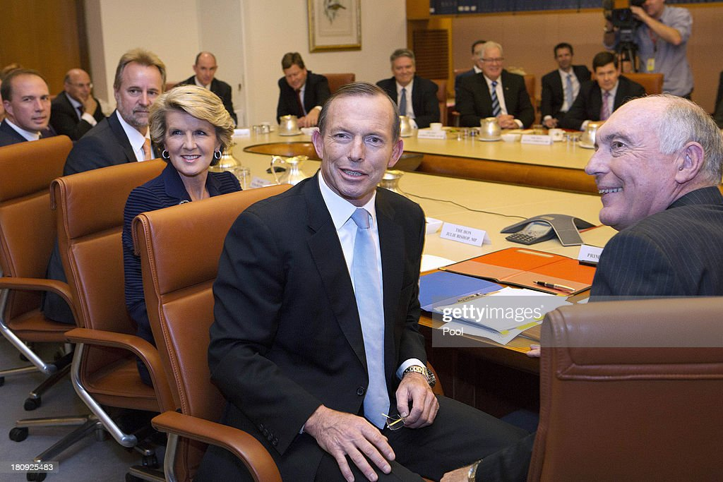 Prime Minister <a gi-track='captionPersonalityLinkClicked' href=/galleries/search?phrase=Tony+Abbott&family=editorial&specificpeople=220956 ng-click='$event.stopPropagation()'>Tony Abbott</a> leads the first meeting of his full Ministry in the Cabinet Room of Parliament House on September 18, 2013 in Canberra, Australia. <a gi-track='captionPersonalityLinkClicked' href=/galleries/search?phrase=Tony+Abbott&family=editorial&specificpeople=220956 ng-click='$event.stopPropagation()'>Tony Abbott</a> was today sworn is as the 28th Prime Minister of Australia, with his parliamentary secretaries and ministers also being confirmed by the Governor-General. Abbott has proclaimed today will be a day of action and plans to start the process to repeal the carbon tax and reduce the number of asylum seeker arrivals.