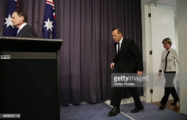 Prime Minister Tony Abbott Minister for Foreign Affairs Julie Bishop and Minister for the Environment Greg Hunt arrive at a press conference to...