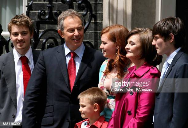 Prime Minister Tony Blair accompanied by his family left to right Euan Kathryn Cherie Nicky Front row Leo pose on the steps of No10 as leaves Downing...