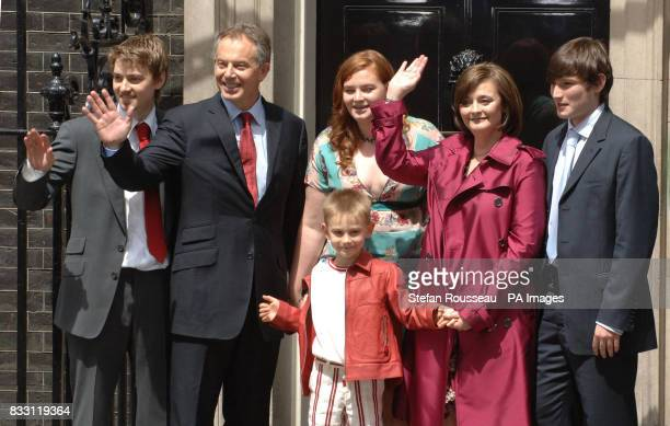 Prime Minister Tony Blair accompanied by his family left to right Euan Kathryn Cherie Nicky and Leo pose on the steps of 10 Downing Street London as...