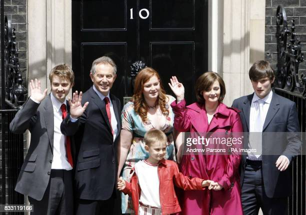 Prime Minister Tony Blair accompanied by his family pose on the steps of No10 as they leave Downing Street London