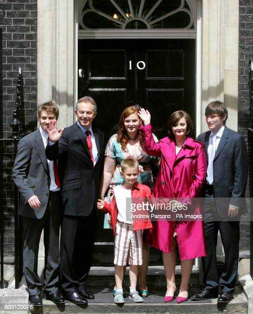 Prime Minister Tony Blair accompanied by his family pose on the steps of No10 as they leave Downing Street London for the final time