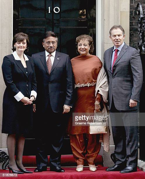 Prime Minister Tony Blair and his wife Cherie stand alongside Pakistan President Pervez Musharraf and his wife Sehba outside 10 Downing Street on...