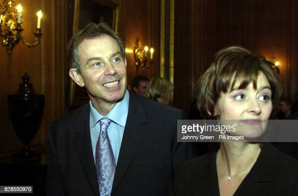 Prime Minister Tony Blair and his wife Cherie stand at a Downing Street tea party held at No 10 Downing Street in central London * 21/11/02 Mr Blair...