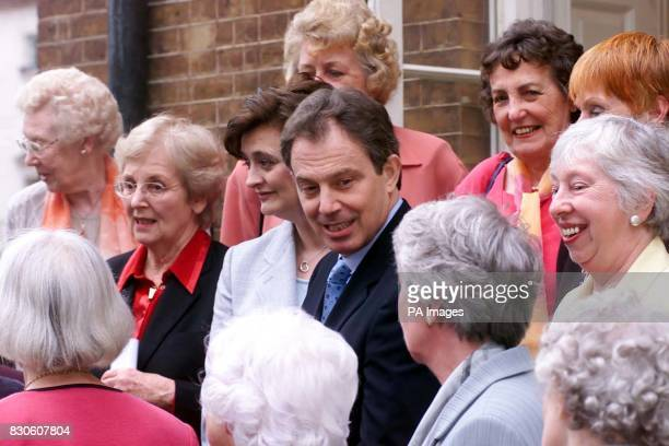 Prime Minister Tony Blair and wife Cherie with and a group of women who in 1951 aged between 18 and 22 were selected as goodwill representatives on a...