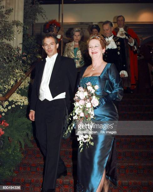 Prime Minister Tony Blair arrives at London's Guildhall with the Lord Mayor David Howard's wife Val for the Lord Mayor's Banquet where he was due to...