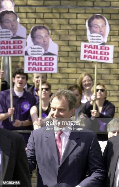 Prime Minister Tony Blair at the St Savior's and St Olave's school in Bermondsey South London as Conservative Party supporters demonstrate over his...