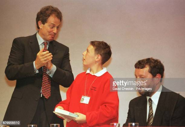Prime Minister Tony Blair congratulates 11yearold Charlie Nobbs after his speech in the Education debate at the Labour Party conference introduced by...