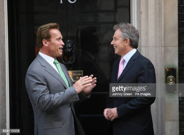 Prime Minister Tony Blair greets the Governor of California Arnold Schwarzenegger on the steps of No 10 Downing Street in central London