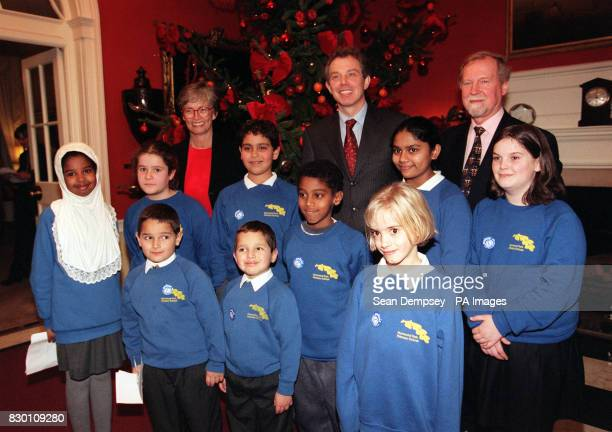 Prime Minister Tony Blair is flanked by Carol Bellamy Executive Director of UNICEF and Robert Smith Executive Director of UNICEF UK at 10 Downing St...