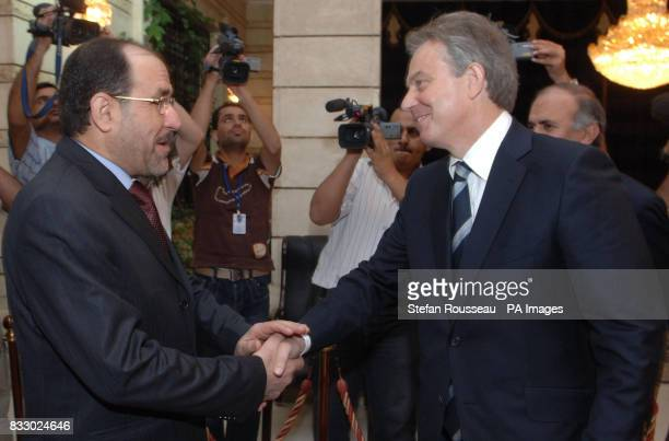 Prime Minister Tony Blair is greeted by his Iraqi counterpart Nouri Maliki in Baghdad today
