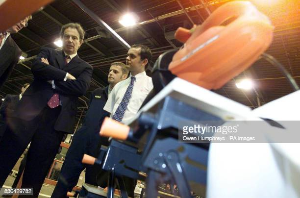 Prime Minister Tony Blair is presented with a special edition electric drill at the Black and Decker factory in Spennymoor County Durham on its 35th...