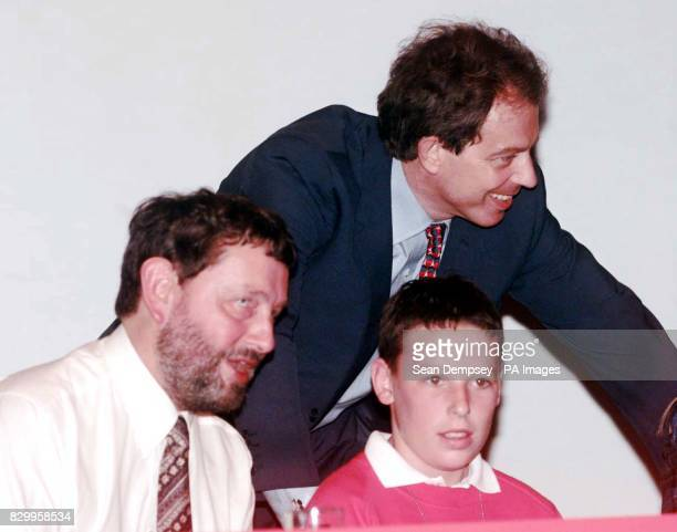 Prime Minister Tony Blair leans over to encourage 11yearold Charlie Nobbs who spoke during today's education debate introduced by Education Secretary...