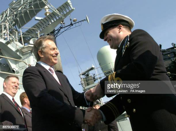 Prime Minister Tony Blair meets a Falklands veteran during a visit to HMS Liverpool at Rosyth dockyard Fife Scotland