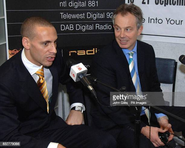 Prime Minister Tony Blair meets Manchester United and England footballer Rio Ferdinand at Zion Arts Centre in the Hulme area of Manchester during a...