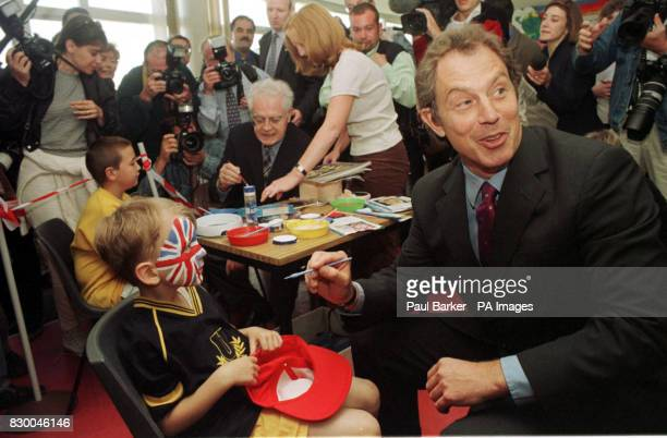 Prime Minister Tony Blair paints a Union Flag on the face of one of his young constituents at the Trimdon Colliery Comunity Centre as French Prime...