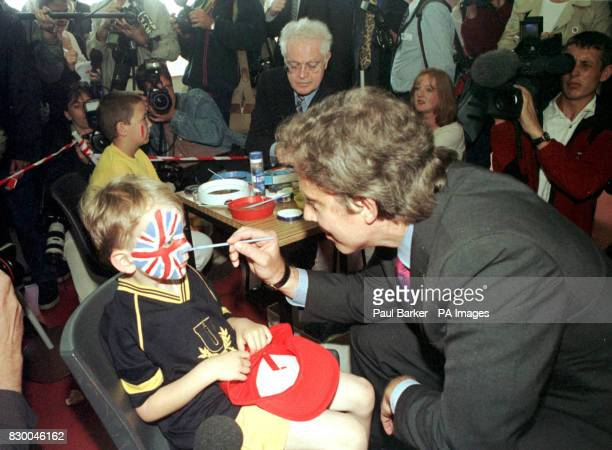 Prime Minister Tony Blair paints a Union jack on the face of one of his young constituents at the Trimdon Colliery Comunity Centre in County Durham...