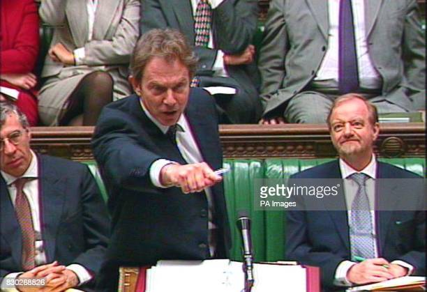 Prime Minister Tony Blair points his finger at the opposition bench during an exchange in House of Commons between Mr Blair and the Conservative...