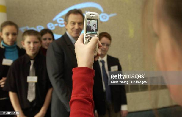 Prime Minister Tony Blair poses with schoolchildren from around the country as 13 year old Juliet Turner from Tunbridge Wells takes their picture on...