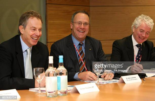 Prime Minister Tony Blair shares a joke with biotechnology executives Dr John Lechleiter and Eli Lilly during a visit to Amgen's headquarters at...