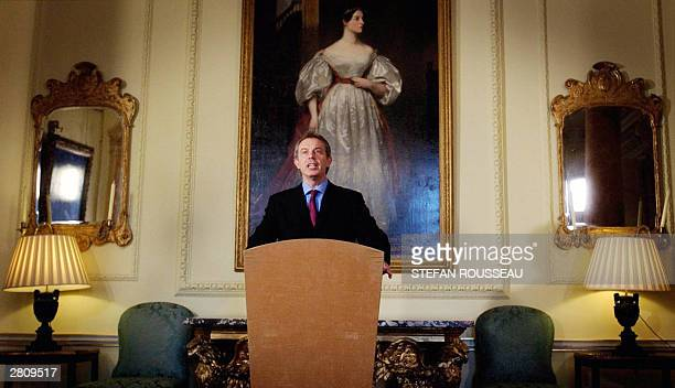 Prime Minister Tony Blair stands in front of the painting Augusta Ada Byron the Countess of Lovelace by Margaret Carpenter during a press conference...