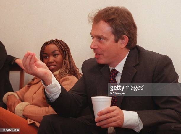 Prime Minister Tony Blair takes tea and talks to young people at the Dalston Youth Project in north London today The project is to educate youths...