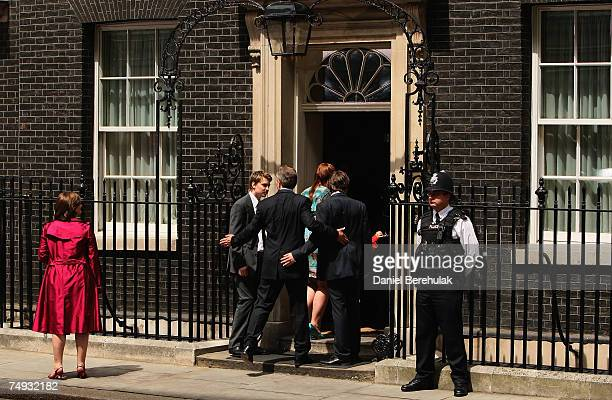 Prime Minister Tony Blair ushers his children into his Downing Street Residence for the final time as Prime Minister on June 27 2007 in London Mr...