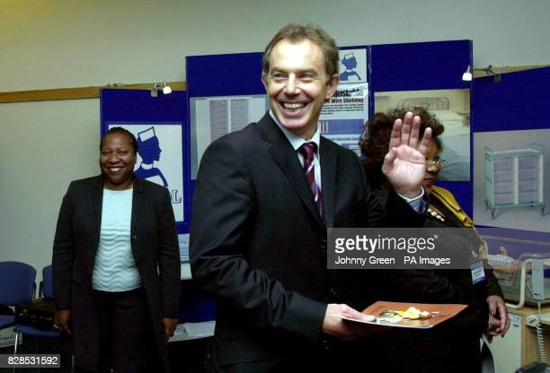 Prime Minister Tony Blair waves goodbye to a group of midwives after addressing an international conference entitled 'Birth Rights Liberty Through...