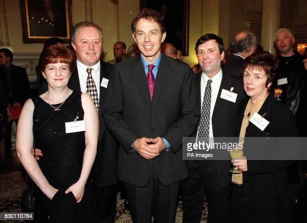Prime Minister Tony Blair with Colette and Barney Herroin from the North and West Belfast Social Services and Roy and Liz Tinsley from the Shankill...