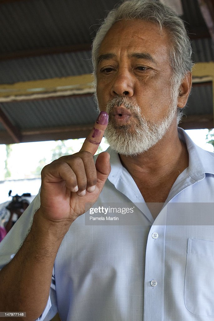 Prime Minister <a gi-track='captionPersonalityLinkClicked' href=/galleries/search?phrase=Xanana+Gusmao&family=editorial&specificpeople=223915 ng-click='$event.stopPropagation()'>Xanana Gusmao</a> jokes with Dili residence while casting his vote during Parliamentary Elections on July 7, 2012 in Dili, East Timor. 21 parties are contesting in the country?s first election without UN assistance. The UN is due to withdraw from the sovereign state in six months if the elections happen in a peaceful and fair manner.