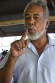 Prime Minister Xanana Gusmao jokes with Dili residence while casting his vote during Parliamentary Elections on July 7 2012 in Dili East Timor 21...