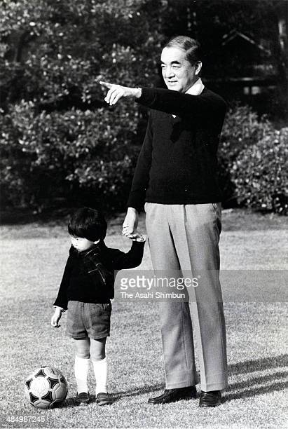 Prime Minister Yasuhiro Nakasone plays with his grandson at his official residence on December 29 1984 in Tokyo Japan Yasuhiro Nakasone is three...
