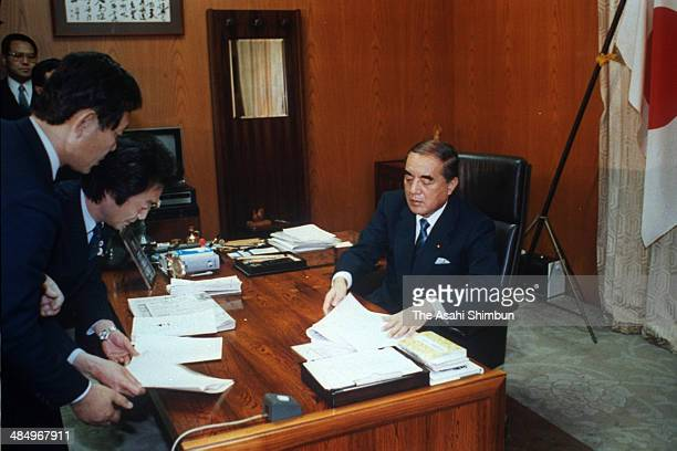 Prime Minister Yasuhiro Nakasone works at his desk at his official residence on December 22 1985 in Tokyo Japan Yasuhiro Nakasone is three times...
