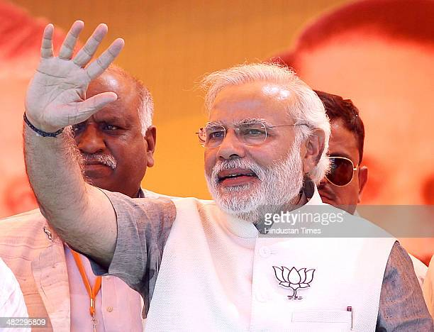 Prime Ministerial candidate Narendra Modi addressing an election rally in the support of Ghaziabad candidate and former Indian Army Chief VK Singh...