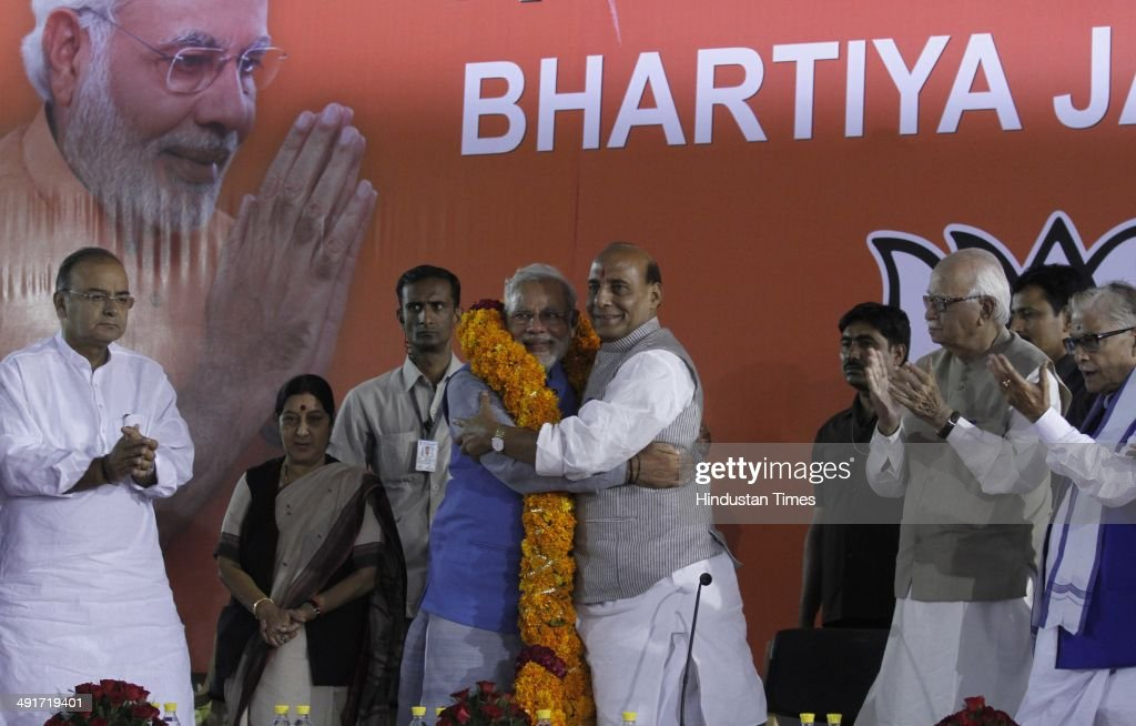 BJP prime ministerial candidate Narendra Modi along with BJP president Rajnath Singh and party senior leaders Arun Jaitely, Sushma Swaraj and LK Advani during the BJP parliament board meeting, after party's landslide victory in Lok Sabha election, at BJP Headquarter office on May 17, 2014 in New Delhi, India. Narendra Modi arrived in the national capital to a rousing welcome by thousands of enthusiastic BJP workers and supporters to whom he gave credit for the historic achievement. He was received at the airport by a number of senior BJP leaders, including party chief Rajnath Singh. As he reached the party headquarters, Modi was showered with rose petals amid chants of his name by supporters. He said, This victory is dedicated to the sacrifices of generations of loyal party workers who have been working tirelessly since 1952. It's the fruit of their blessings, prayers and hard work.