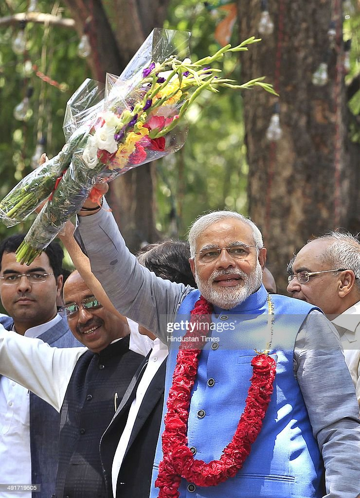 BJP prime ministerial candidate Narendra Modi along with party senior leaders arrive to attend BJP parliament board meeting, after his party's landslide victory in Lok Sabha election, at BJP Headquarter office on May 17, 2014 in New Delhi, India. Modi arrived in the national capital to a rousing welcome by thousands of enthusiastic BJP workers and supporters to whom he gave credit for the historic achievement. He was received at the airport by a number of senior BJP leaders, including party chief Rajnath Singh. As he reached the party headquarters, Modi was showered with rose petals amid chants of his name by supporters. He said, This victory is dedicated to the sacrifices of generations of loyal party workers who have been working tirelessly since 1952. It's the fruit of their blessings, prayers and hard work.