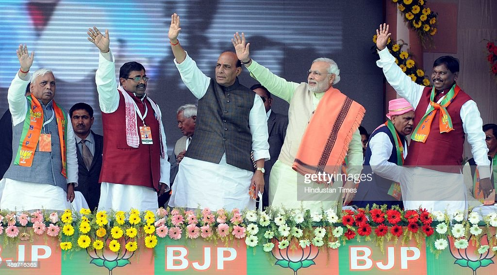 Prime Ministerial candidate Narendra Modi and BJP President Rajnath Singh with seniors BJP state leaders during the Vijay Sankalp rally at HEC...