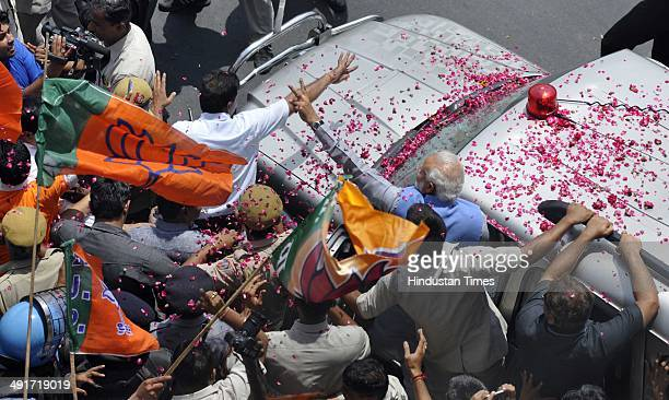 BJP prime ministerial candidate Narendra Modi during his road show from Airport to BJP headquarter after partys victory in Lok Sabha election at...