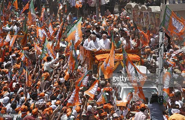 Prime Ministerial candidate Narendra Modi surrounded by huge crowd of supporters on his way to the district collectors office to file his nomination...