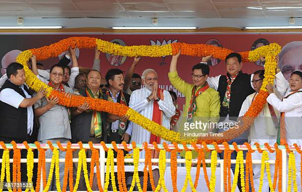 Prime Ministerial candidate Narendra Modi welcomed by local leaders during campaign rally for Lok Sabha election 2014 at Indira Gandhi Park on March...