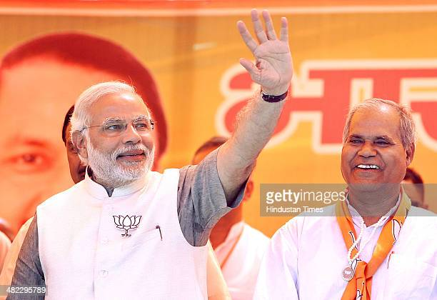 Prime Ministerial candidate Narendra Modi with former Congress leader Ramesh Chand Tomar during an election rally in the support of Ghaziabad...