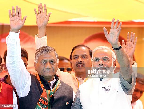 Prime Ministerial candidate Narendra Modi with Ghaziabad candidate and former Indian Army Chief VK Singh and Gautam Budh Nagar candidate Mahesh...