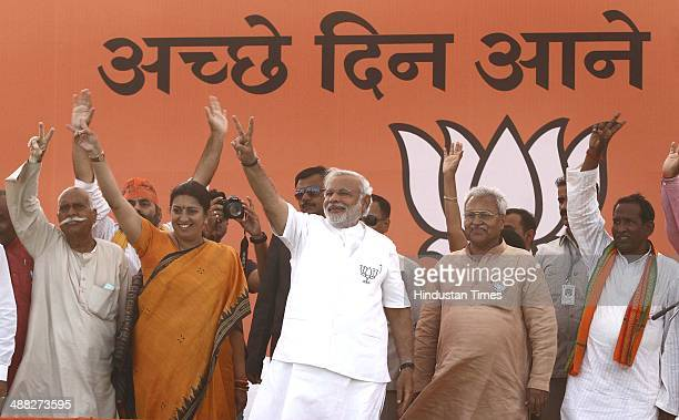 BJP prime ministerial candidate Narendra Modi with Smriti Irani BJP candidate from Amethi constituency and others leaders during an election campaign...